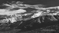 Black and white photo of snow capped mountains in southern Greece